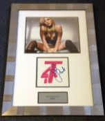 Pink signed T4 logo mounted and framed below colour photo of the singer. Approx overall size