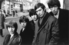 Charlie Watts signed 12x8 black and white photo pictured with his fellow Rolling Stones band