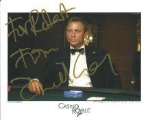 Daniel Craig signed 10x8 Casino Royale colour photo. Dedicated. Craig achieved international fame