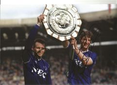 Peter Reid and Wayne Clarke Everton Signed 10 x 8 inch football photo. This item is from the stock