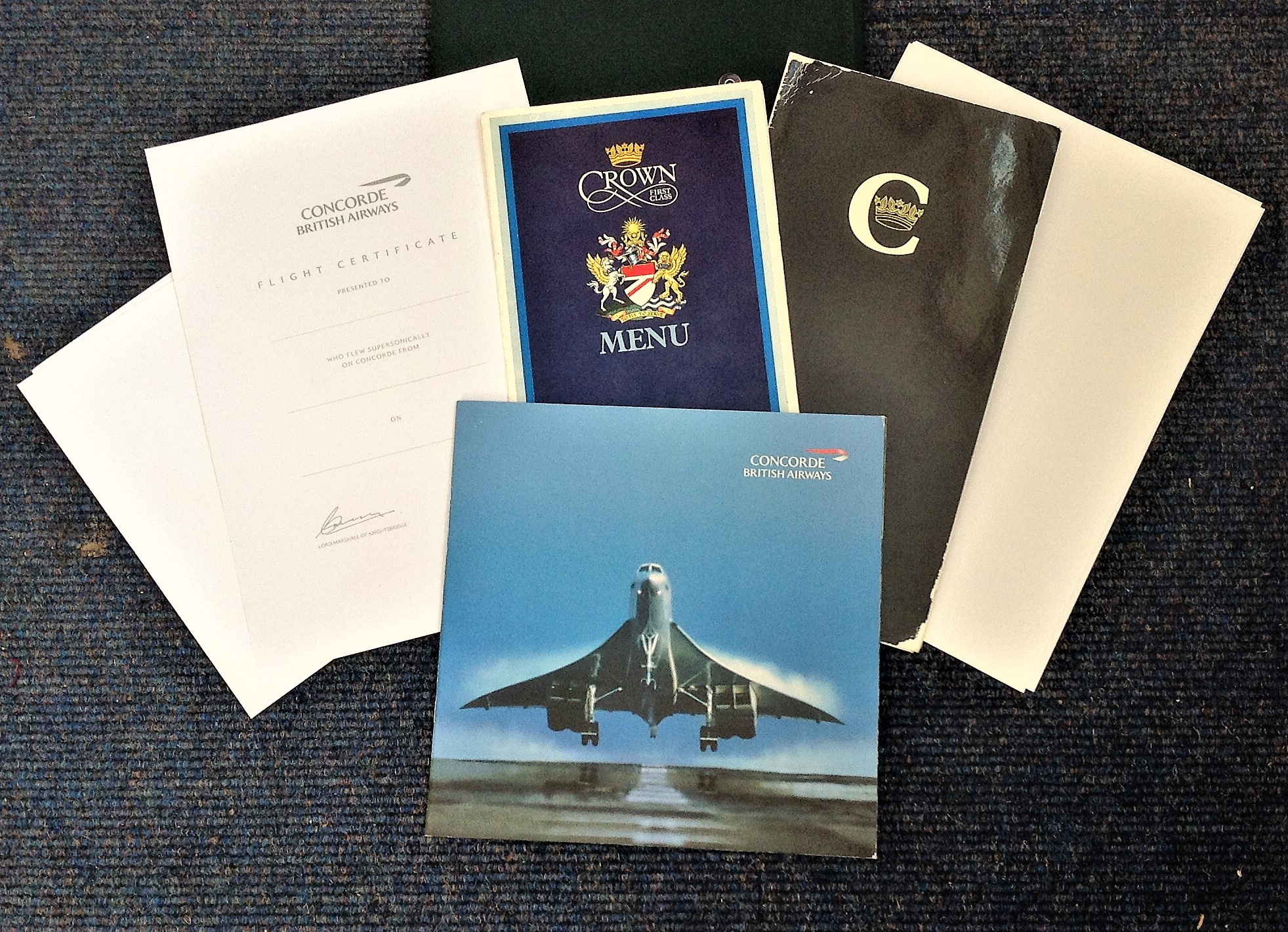 Concorde Folder containing Booklets, Menus and other commemorative items issued on Concorde flights.