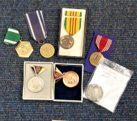 Military medal collection 7 interesting items includes 3 USA medals, 1 Polish WW2, 2 East German and
