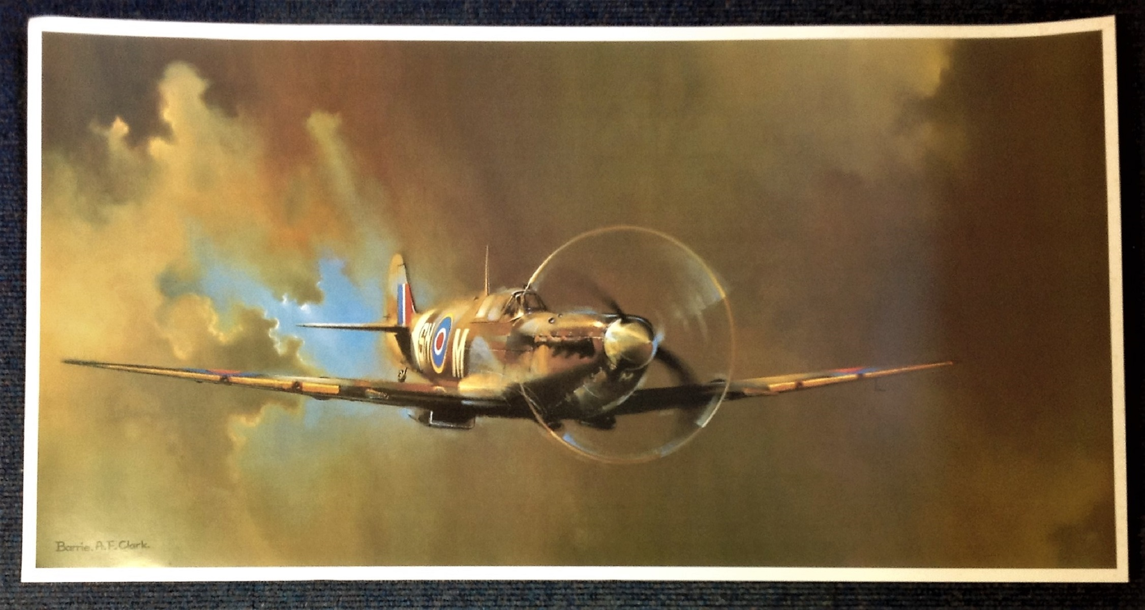 Battle of Britain 36X19 print picturing a Spitfire in flight by the artist Barrie. A. F. Clark. Good
