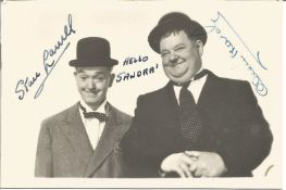 Laurel and Hardy signed 6 x 4 inch b/w photo inscribed Hello Sandra.