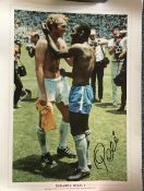Pele signed 16 x 12 inch colour photo swapping shirt with Bobby Moore.