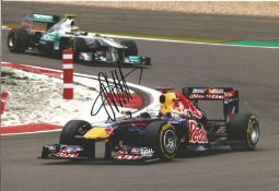 Motor Racing Sebastian Vettel signed 12x8 colour photo pictured while driving for Red Bull in