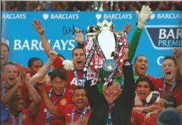 Football Alex Ferguson signed 12x8 colour photo pictured celebrating with the Premier League Trophy.