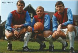 Football Martin Peters signed 12x8 colour photo pictured with his West Ham team mates Bobby Moore