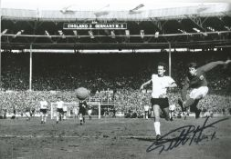 Football Geoff Hurst signed 12x8 black and white photo pictured scoring in the 1966 World Cup final.