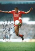 Football John Barnes signed 12x8 colour photo pictured in action for Liverpool. Good Condition.