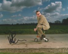 Vic Reeves Comedian signed 10 x 8 colour photo riding tiny bike. All autographs come with a