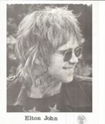 Elton John signed young 10 x 8 inch b/w matt photo to Michael. DLM records promo.