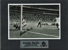 Gordon Banks signed 10 x 8 inch b/w photo of his legendary Pele save, mounted with plaque to 16 x 12