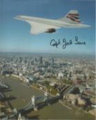 Capt Jock Lowe signed 10x8 colour Concorde photo flying over London. All autographs come with a