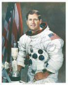 Space Astronaut William Pogue signed 10x8 colour spacesuit photo. All autographs come with a