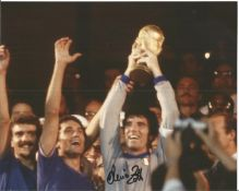 Dino Zoff signed 10x8 colour photo holding the World cup aloft. All autographs come with a