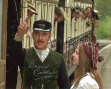 The Railway Children. 8x10 photo signed by actor Bernard Cribbins and actress Sally Thomsett. All