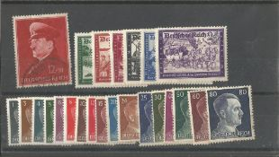 German stamp collection 1 stock card 24 stamps dated 1941 catalogue value £24. We combine postage on