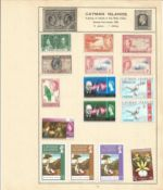 British Commonwealth stamp collection 5 loose album leaves from Ceylon and the Cayman Islands. We