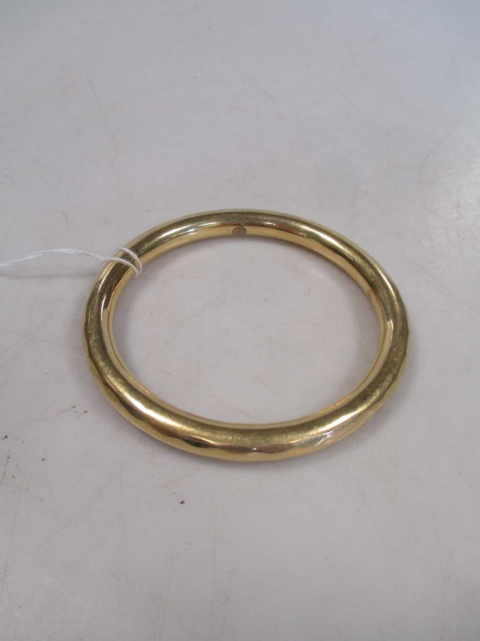 A slave bangle, tests to 18ct 30.7g