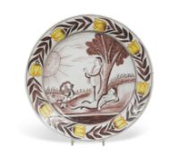 An 18th century Delft polychrome 'Adam and Eve charger,