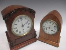 A mid 19th century walnut cased mantle clock, 29cm high, together with another mantel clock, the