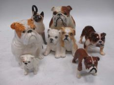 A Beswick pottery bulldog, 'Basford British Mascot', a Royal Doulton seated bulldog, a group of