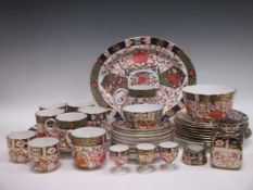 A quantity of matched Royal Crown Derby and Crown Derby imari plates, cups, slop bowl etc