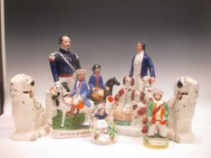 A Victorian Staffordshire flatback figure of Napoleon, 28cm high, another of the Prince of Wales,
