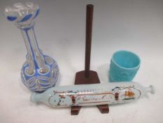 A Nailsea glass rolling pin, 32cm long; a blue pressed glass beaker, 9.5cm high, a Vaseline glass