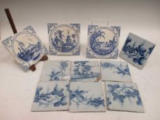 Seven 18th century Delft blue and white tiles decorated with grape vines and three Minton blue and