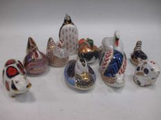 A group of Royal Crown Derby paperweights to include a pig, swan, penguin, snail, cock, chicken,