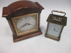 A Matthew Norman carriage clock together with a wooden cased mantel clock by Elliott (2)