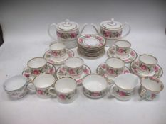 A Royal Worcester Royal Garden 1969 part tea service with rose decoration