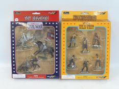 Two sets of boxed Britains figures, one of American Civil War Confederate Cavalry, the second a Wild