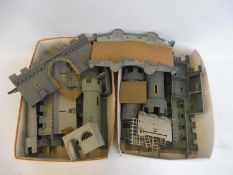 Two boxes full of Airfix Medieval castles, overpainted.