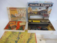 A Timpo Prairie Rocket, American Heritage and a tank battle game (unchecked).