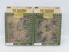 Two sets of boxed Britains figures, one of WWII British Infantry, the other WWII US Infantry.