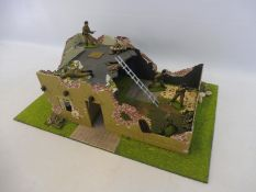 A well painted diorama British Commandos WWII bomb-damaged buildings.