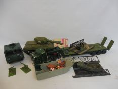 A box full of large scale painted military vehicles.