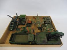 A tray of plastic military vehicles, all painted.