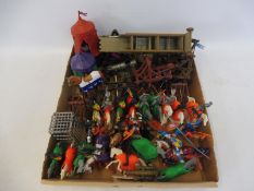 A tray of medieval knights on horseback and accessories to include tents, catapults etc.