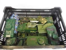 A box of plastic figure scale heavy artillery to include tanks etc.