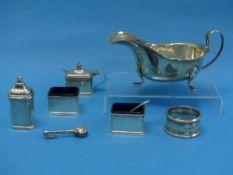 A George V silver four piece Cruet Set, by alker & Hall, hallmarked Birmingham, 1927, of rectangular