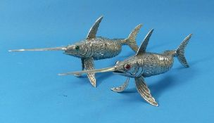 A pair of Spanish silver Articulated Model Sword Fish, marked on pectoral fins, one with green glass