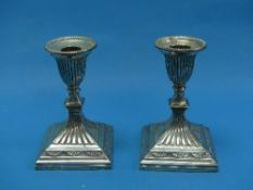 A pair of Victorian silver short Candlesticks, by Hawksworth, Eyre & Co., hallmarked Sheffield,