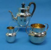 An Edwardian silver three piece 'bachelor' Tea Set, by H J Cooper & Co Ltd., hallmarked