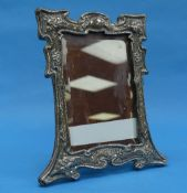 An Arts & Crafts silver Easel Frame, by Sydney & Co., hallmarked Birmingham, 1903, with stylised