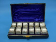 A cased set of twelve late Victorian silver Napkin Rings, by Hilliard & Thomason, hallmarked