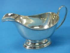 A George V silver Sauce Boat, by Henry Clifford Davis, hallmarked Birmingham, 1919, of traditional